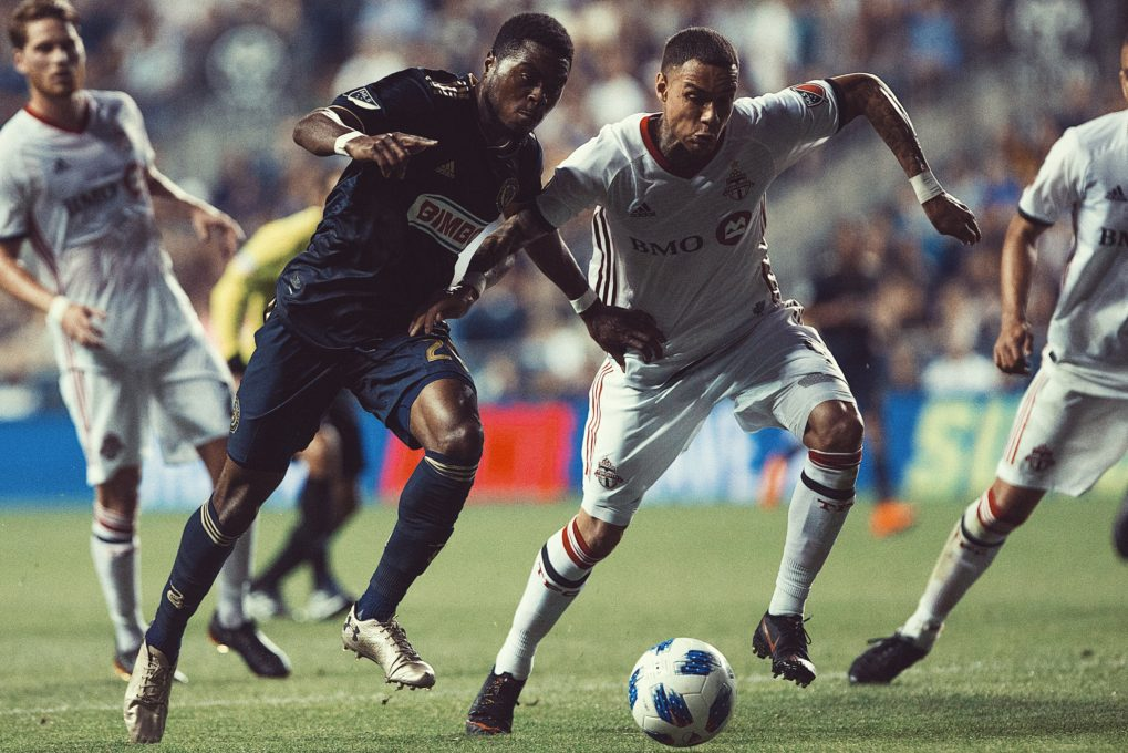 Gregory van der Wiel dueling with a Philadelphia Union player