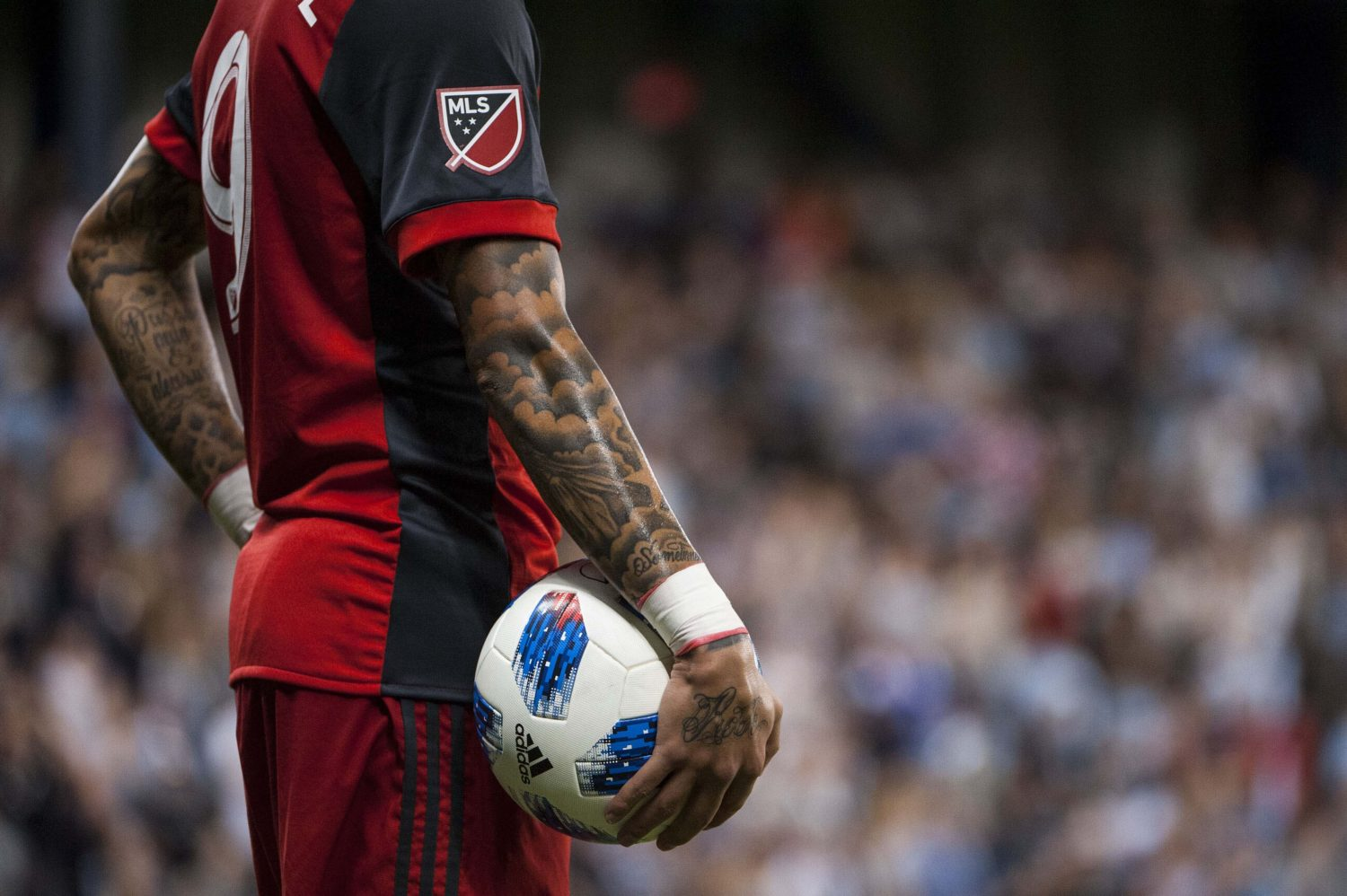 Gregory van der Wiel - Holding a Adidas ball during Toronto FC vs Sporting KC
